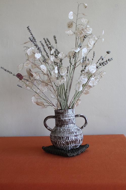 black handled vase