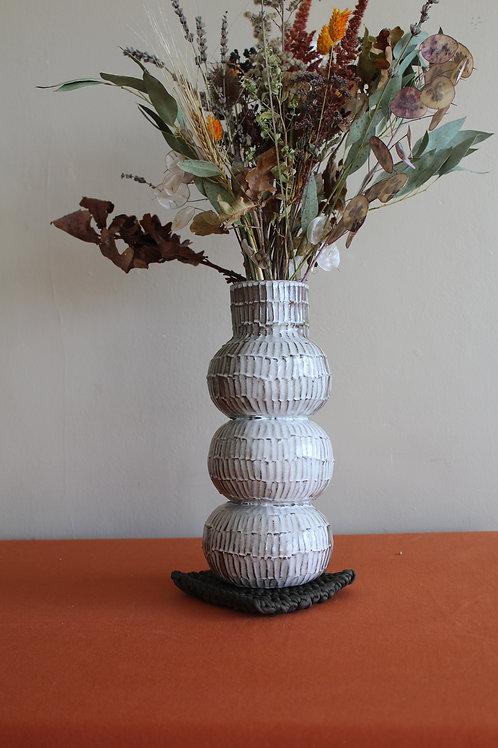 black tall ridged vase