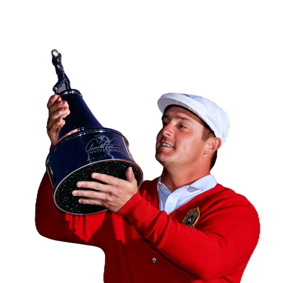 DeChambeau hoisting the winner's trophy after a 1-stroke victory over Lee Westwood