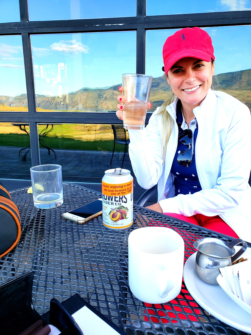 instagram star Graci Zermiani enjoying an after golf cider at Tobiano golf course and Flat Iron Grill in Kamloops BC.