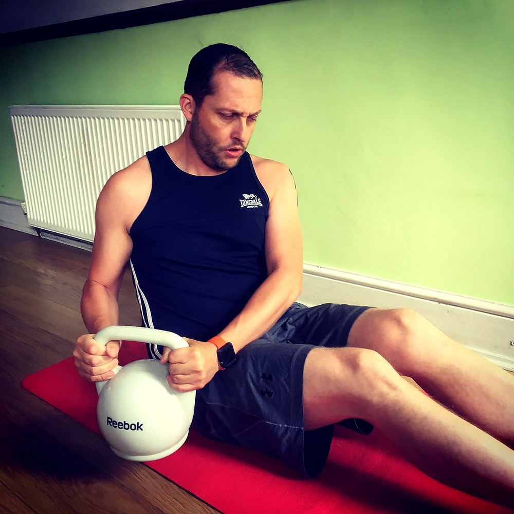 kettleball, russian twist, forearm strength, prevention elbow injuries
