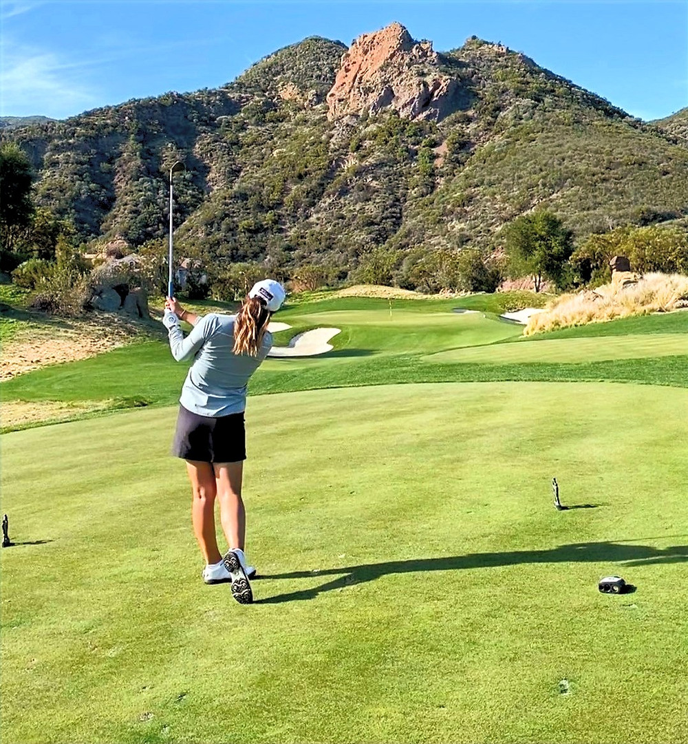 Canadian professional golfer, Rebecca Lee_Bentham, holds her finish after hitting her tee shot into a par 3 at Sherwood Country Club in Thousand Oaks, California