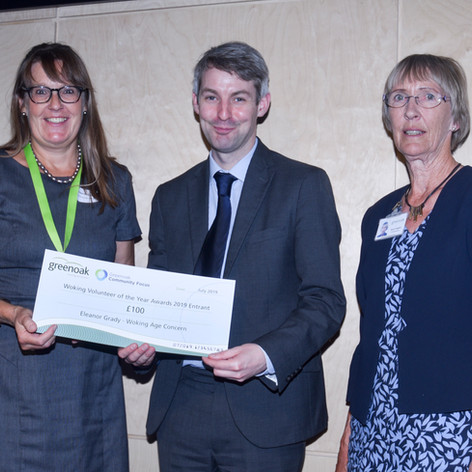 Wokign Age Concern receives a cheque for £100 at Greenoaks' Woking Volunteer of the Year Awards 2019
