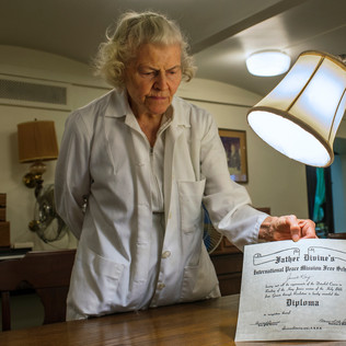 Miss Janet Kay with Father Divine Diploma
