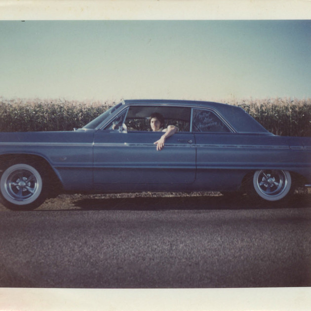 Sergio and his 1964 Impala Super Sport on a road trip from East LA to San Francisco after high school graduation, Imperials Car Club, 1971