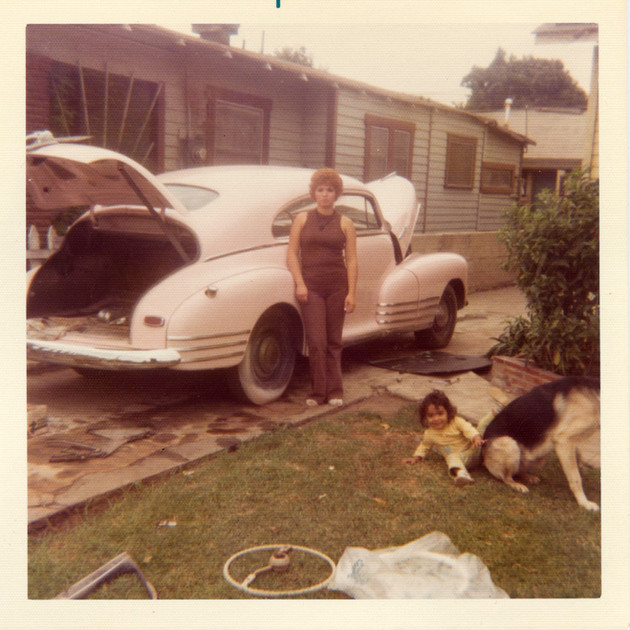 """Virginia and Suzette with Oscar's 1948 Chevy """"Pink Panther"""", South Central, 1970s"""
