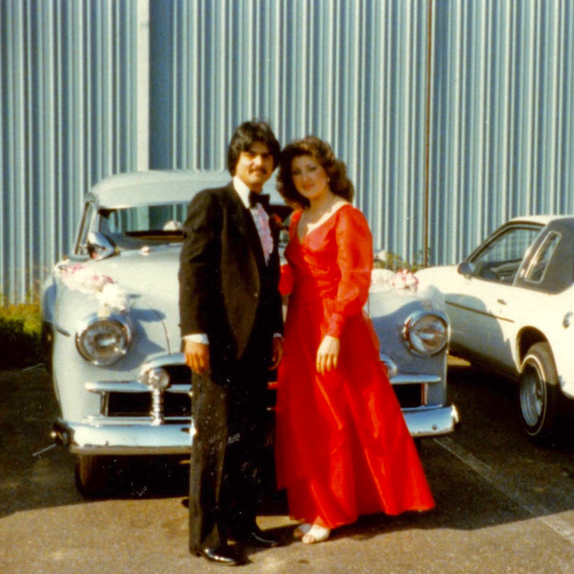 Groomsman and bridesmaid with 1950 Chevy Fleetline and Chevy Monza, Los Angeles, 1970s