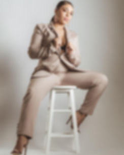 Indigo Marshall sitting on white stool for Therapy photoshoot