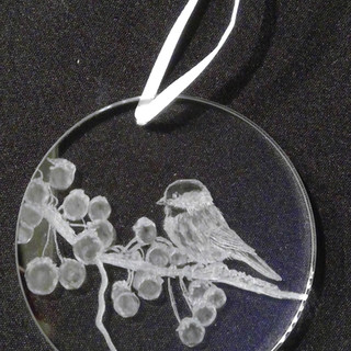 Chickadee on berry branch