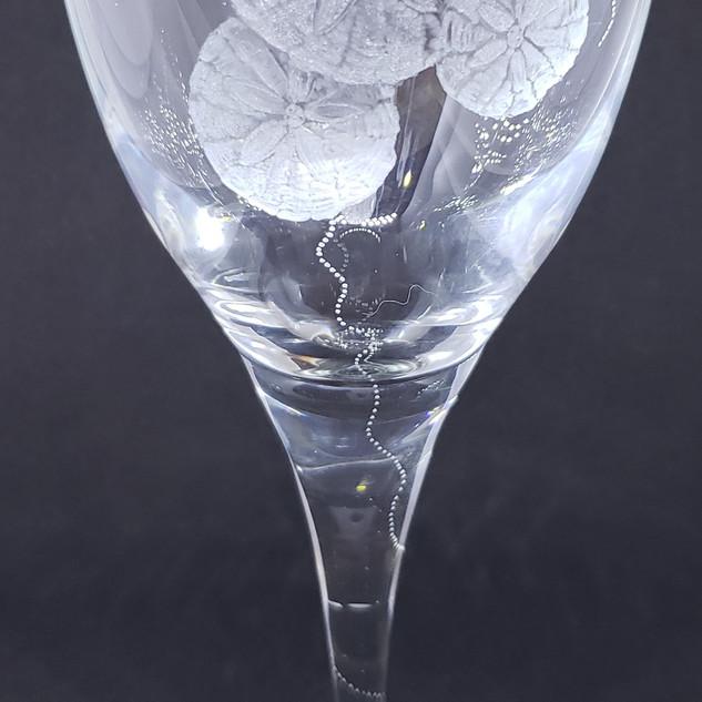 sand dollars on wineglass