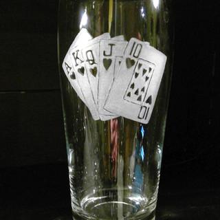 poker hand beer glass