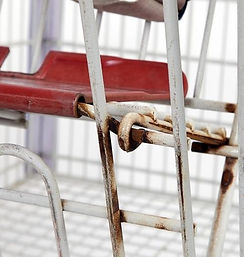 Rusted shopping cart before remanufacture
