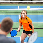 Laughing playing pickleball.jpg
