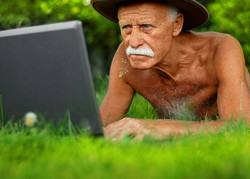 Old Man Looking Up Website in Grass