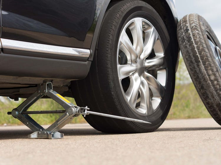 How to Change A Tire on YOUR Car