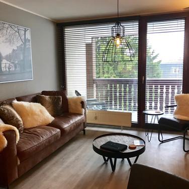 Moderne en ruime woonkamer van Kappeberg Lodge