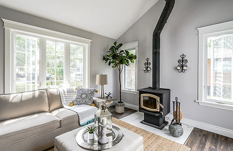 Modern bright living room with fireplace. Real estate photo from Niagara home.