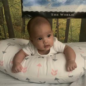 Baby Using Boppy Nursing Pillow for Eating & Tummy Time