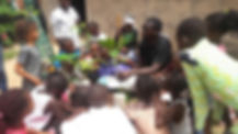 A teacher in The Gambia tells children a