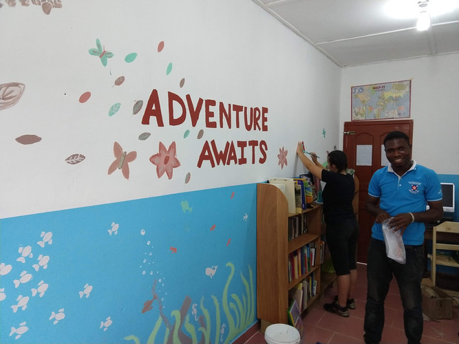 Villagers and volunteers help build new library