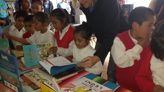 Children picking books to read in Mexico