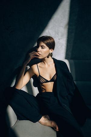 Woman wearing tuxedo with bra