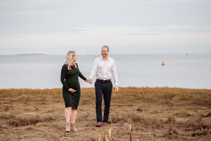 Expecting couple on beach