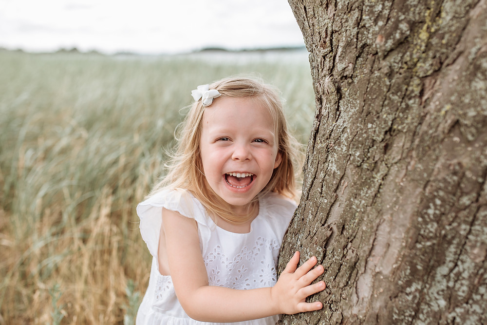 Little Girl Laughing. South Shore MA Family Photographer. Kristen Hourihan Photography