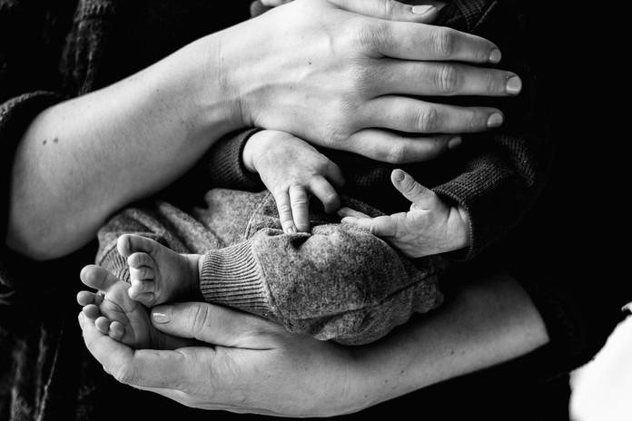 Newborn in mom's hands