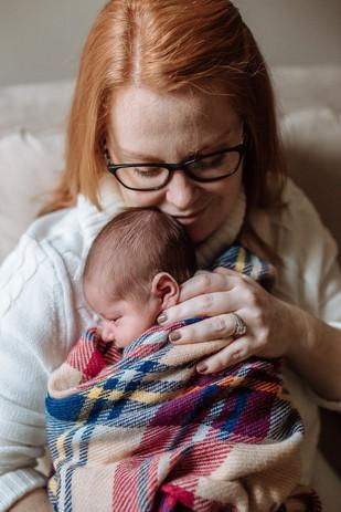 Mom cuddling baby
