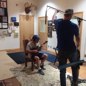 Kurt Nielsen (Frenchy) doing mandolin parts at Teegarden Studio. Brett Baldwin is getting him all fixed up.