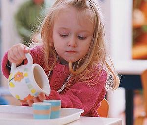 Child with Mont prac life mat.jpg
