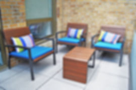 The outdoor space of the Bernstein Real Estate office has modern seating with access to gorgeous views of the New York skyline.