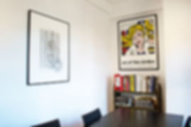 Geometric abstract art and a Roy Lichtestein poster in the conference room of Chris Boals Artists office space. Designed by Lenart Architecture.