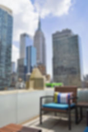 Bernstein Real Estate offices have a gorgeous panoramic view the Empire State building and overlooks Midtown Manhattan in New York City.