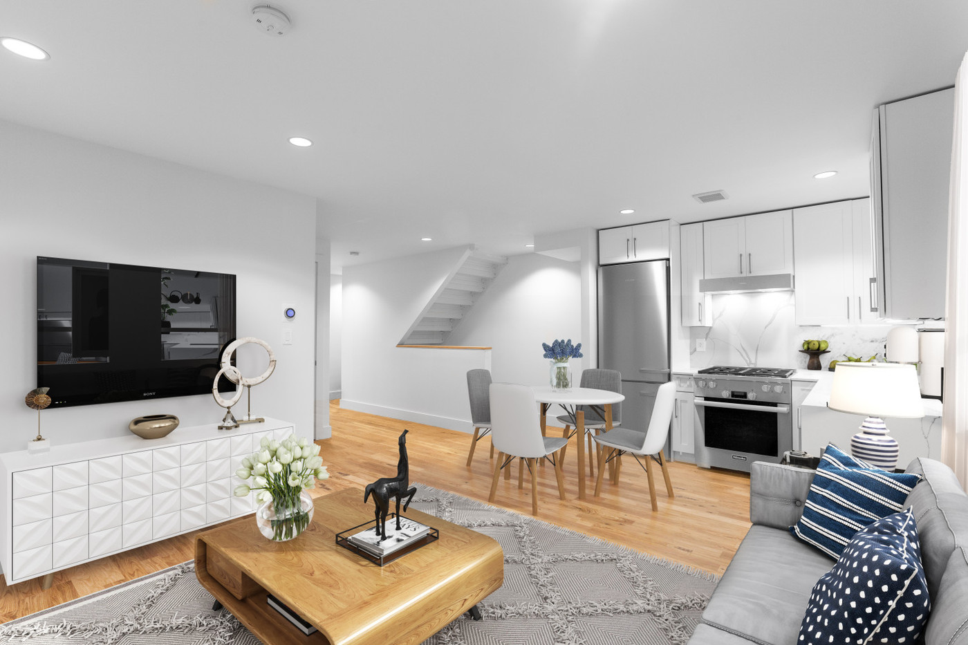 64_2nd_Kitchen_Living_Dining_Staged.jpg