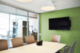 Bernstein Real Estate conference room with green accent wall. Office Fit out.