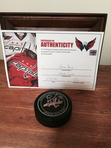 Autographed game puck by Brooks Laich with Certificate of Authenticity