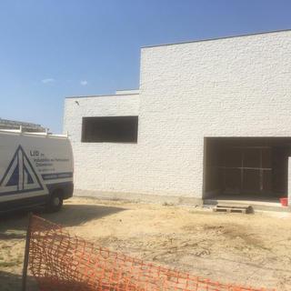 Plat dak met PIR isolatie en Rhepanol waterdichting - Woning Hechtel Eksel