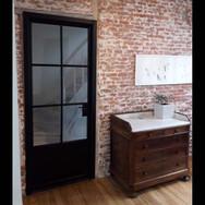 enkele smeedijzeren - stalen deur met omkasting te Leuven