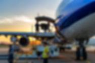 Airplane-near-terminal-186763256_1256x83