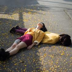 Girls Lying on Ground
