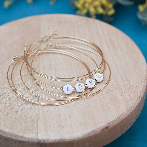 bracelet semainier avec perles LOVE en acier inoxydable doré