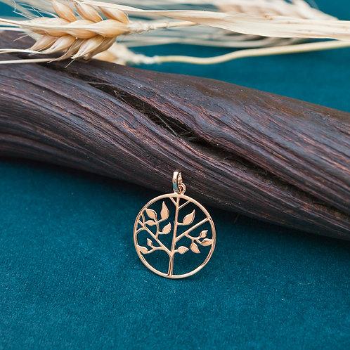 pendentif rond en plaqué or avec un arbre ciselé
