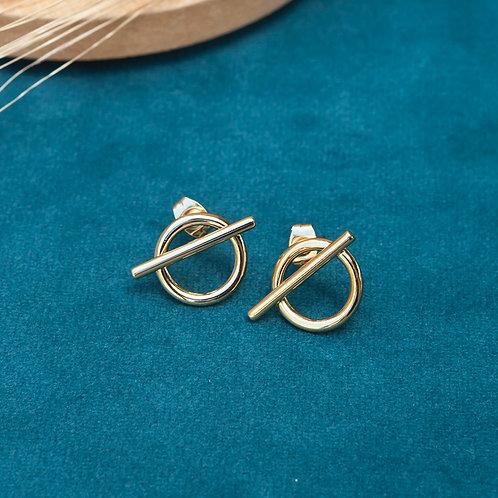 boucles d'oreilles en forme de cercle avec une barre verticale en acier inoxydable doré