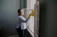 A Person Disinfecting a Room