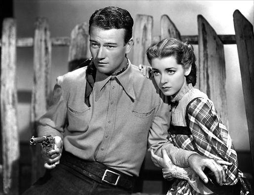 2. Still of John Wayne and Marsha Hunt i