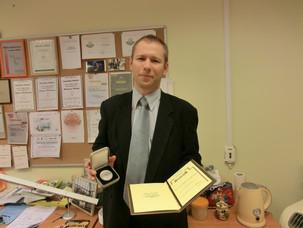 Egils Stalidzans receives a medal for Diligence