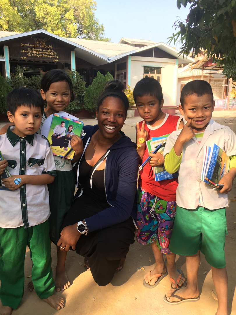 Sharing stickers with children at a Monestary in Myanmar