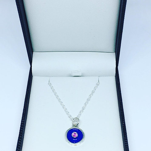 Silver birthstone pendant with sapphire blue enamel & a pink sapphire